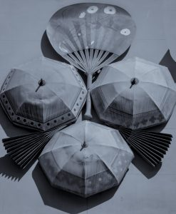 Fans and Umbrellas decorate this building facade in Barcelona Spain