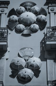 Umbrellas and fans attached to the facade of a building in Barcelona Spain