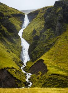 Waterfall crashes down steep mountain in Iceland