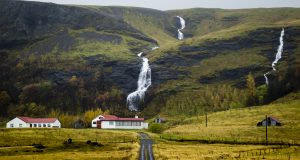 Farmhouse with two waterfalls in Iceland