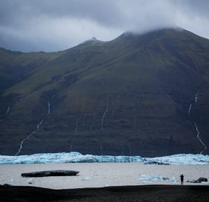 Edge of glacier with photographer in Iceland