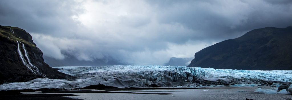 Glacier between two mountains in Iceland